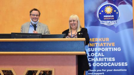 Waveney MP Peter Aldous calling out the bingo numbers at Merkur Bingo Lowestoft with club operations manager Tracy Hayward.