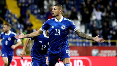 Bosnia and Herzegovina's Rade Krunic celebrates scoring his side's first goal of the game during the