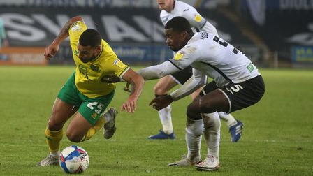 Onel Hernandez of Norwich City and Marc Guehi of Swansea City battle for the ball during the Sky Bet