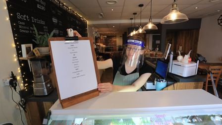 Louisa Ingleton puts out a menu for a free breakfast for children at the Rumour Cafe in Sheerness Ke