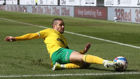 Emiliano Buendia of Norwich leaps to keep the ball in play during the Sky Bet Championship match at