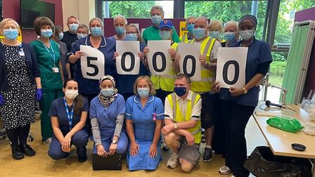 Volunteers and medical staff celebrate the 50,000 vaccines administered at Lionwood Medical Practice in Norwich.