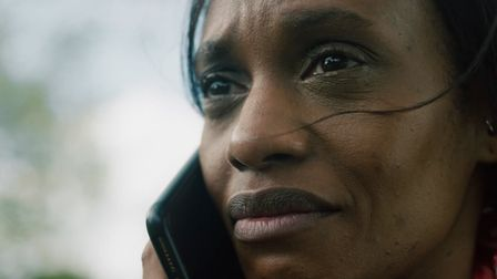 Women on phone to Solace Women's Aid in new awareness campaign video.