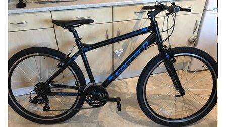The black Carrera bike, with blue writing, which was stolen.