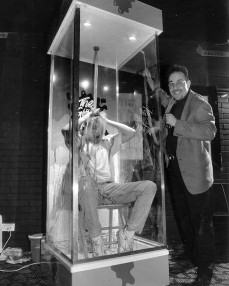 Rick's Place managers Paul Breslin (left) and Paul Allen demonstrate the infamous gunge machine. Dat