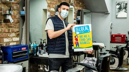 Pas Bertolino, of Stasi Barbers and Academy in Junction Road, Archway, promoting the Covid-Safe Business Award scheme