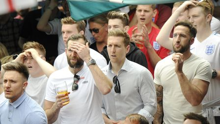 Spectators watch the England v Wales Euro 2016 Match at Issacs on the Quay.
