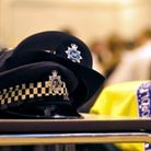 A police hat and vest.