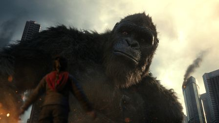 Kaylee Hottle as Jia with Kong in the Godzilla vs Kong action adventure.