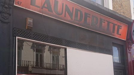 The England's Lane Launderette was boarded up on Thursday after the shocking fire
