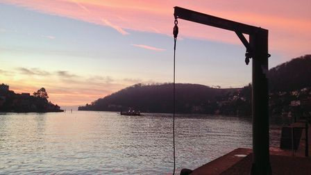 Sunset in Dartmouth with the car ferry crossing