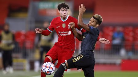 Liverpool's Neco Williams (left) and Ajax's David Neres battle for the ball during the UEFA Champion