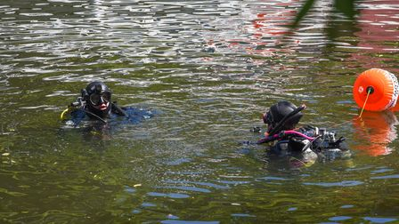 Scuba divers getting litter out of the River Wensum as part of the Green Party's litter pick in Norw