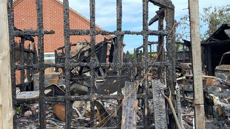 The remains of Ken Weatherly's workshop and studio in Cromer which was destroyed by a fire on Saturday, June 5.