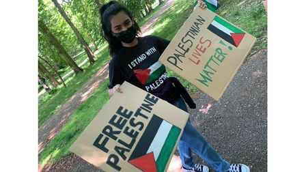 A protesterwith homemade signs in Christchurch Park