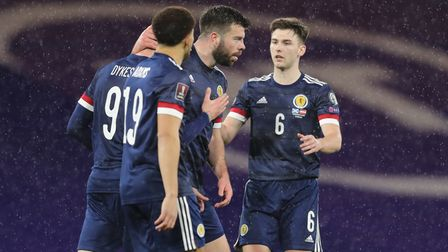 Scotland's Grant Hanley (centre) celebrates with team-mates after scoring their side's first goal of
