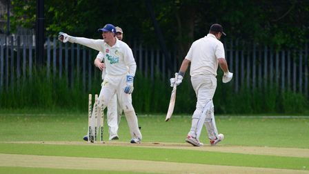 Newham's Salman Khan walks off having been stumped by Laurence Pulford
