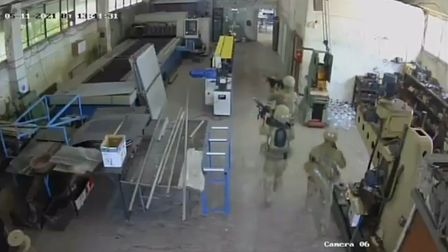 CCTV footage of the173rd airborne brigade troops inside the olive oil factory