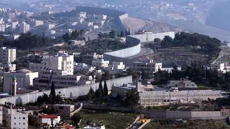 The Israeli West Bank barrier between Jerusalem (right) and Bethany (left).