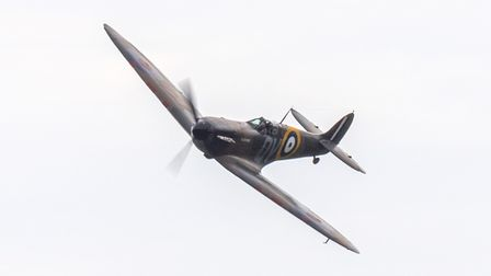 A Supermarine Spitfire Mk1a in flight at the Commemorate D-Day event at IWM Duxford