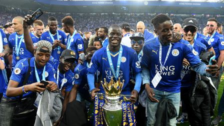 Ngolo Kante of Leicester City poses with the Premier League Trophy , May 7, 2016
