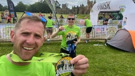 Garden City Runners with medals at the Hertfordshire Half at Knebworth