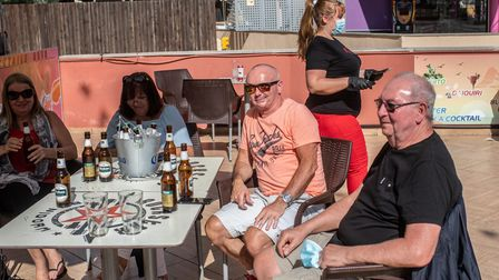 BENIDORM, SPAIN - MAY 11: British expats enjoy the atmosphere at the terrace of a bar opened for the