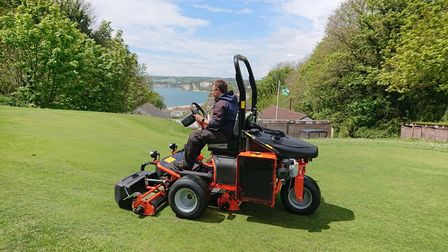 Looking after the greens at Axe Cliff
