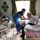 Careworker Fabiana Connors visits client Jack Hornsby at his home during the coronavirus pandemic in