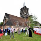 The Rev'd Alan White, along with the choir and congregation from St Jude's Church