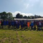 Forest United players and supporters in front of the dilapidated club house