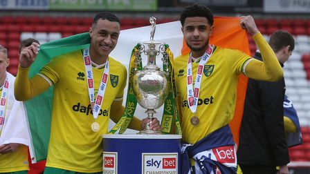 Adam Idah of Norwich and Andrew Omobamidele of Norwich with the EFL Championship trophy at the end o