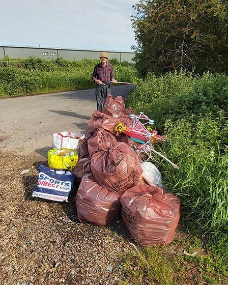 Bagged up fly-tipped rubbish in New Drove Lane
