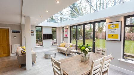 Extra dining room and living room space created from a flat roof extension installed with skylights from FineLine in Kent.