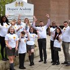 Students at Drapers' Academy cheer in their Saint Francis Hospice t-shirts