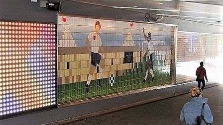 Footballers on the mural on the east wall from the station steps