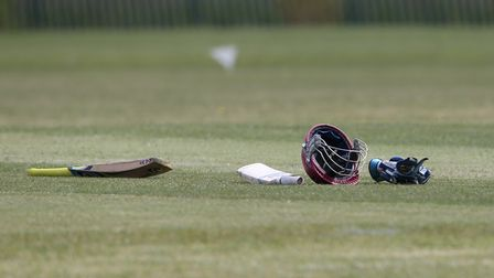 Cricket equipment is left lying by the pitch
