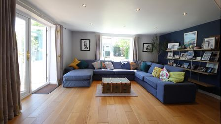 The sitting room featuresdouble doors opening onto the rear garden