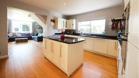 The fitted kitchen features a central island with storage below