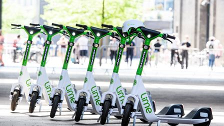 EDITORIAL USE ONLY A group of electric scooters as Lime announces a year-long trial in partnership w