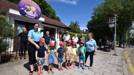 Planet Tiny toddlers outsidethe Priory Road nursery with staff and local residents