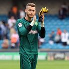Angus Gunn of Norwich applauds the traveling support at the end of the Sky Bet Championship match at