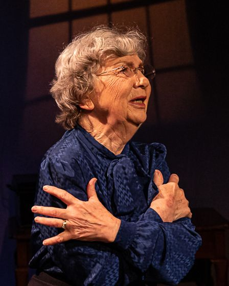 An actress on stage at The Tower Theatre Company