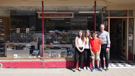 The new owners of White & Son Shoes, Steve and Sarah Ryrie, and their children, outside the shop on Fore Street