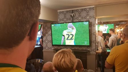 Nick Moore watching the game in The Woolpack Inn. Picture: Marc Betts