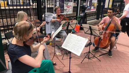 Local musicians playing at the community bash