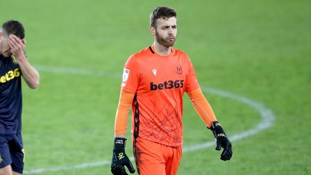 Stoke City goalkeeper Angus Gunn (right), James Chester and John Obi Mikel appear dejected at the en