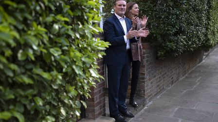 Labour leader, Sir Keir Starmer and his wife Victoria Starmer applaud for key workers outside their