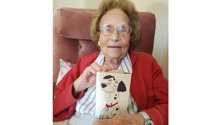 Joan Nott with her card, made by her grandsonGeorge