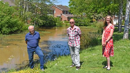 Members of theGunton Residents' Association and theGainsborough Drive Pond Group at the pond.